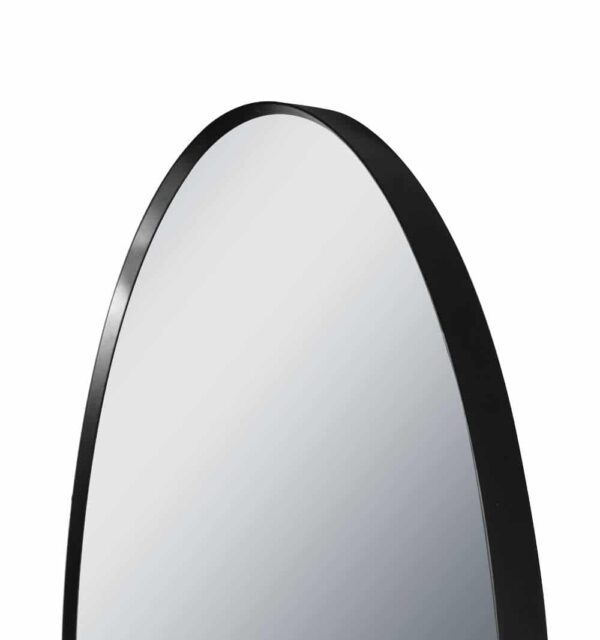 Round wall mirror detail view above TALOS BLACK CIRCLE